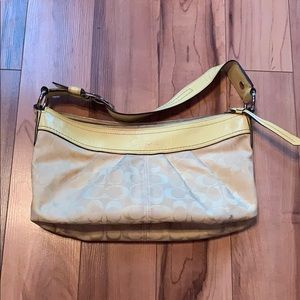 Small yellow coach bag